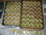 Trays of filled cups, cooling